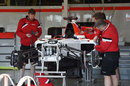 Mechanics work on the Manor F1 car