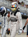 Lewis Hamilton celebrates taking pole position in Melbourne