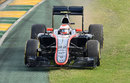 Jenson Button takes a detour across the grass at Turn 1