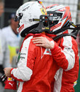 Kimi Raikkonen greets Ferrari team-mate Sebastian Vettel after qualifying