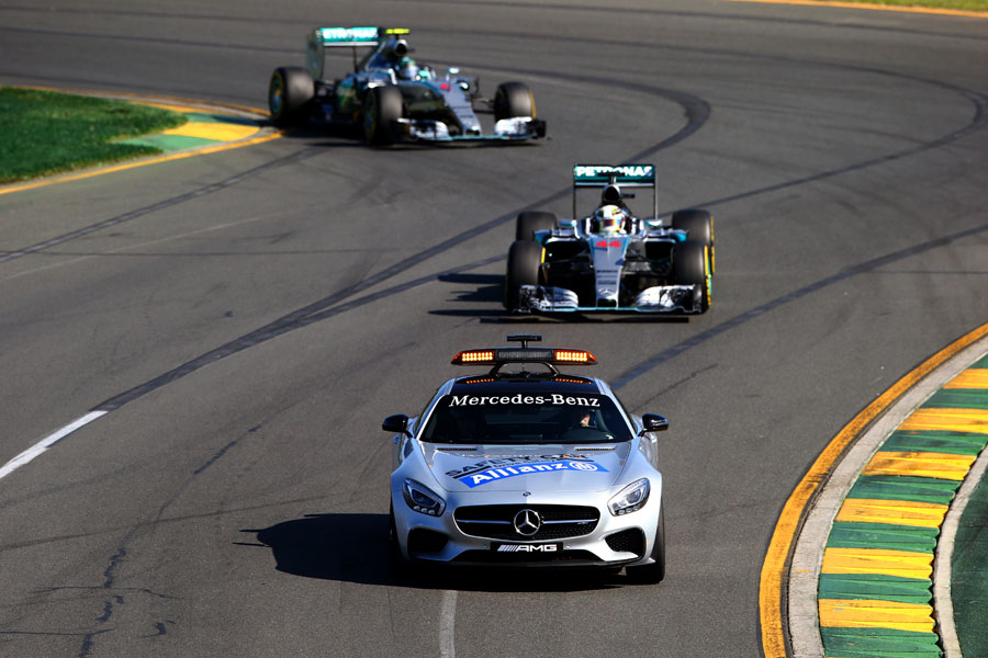 The safety car leads Lewis Hamilton and Nico Rosberg