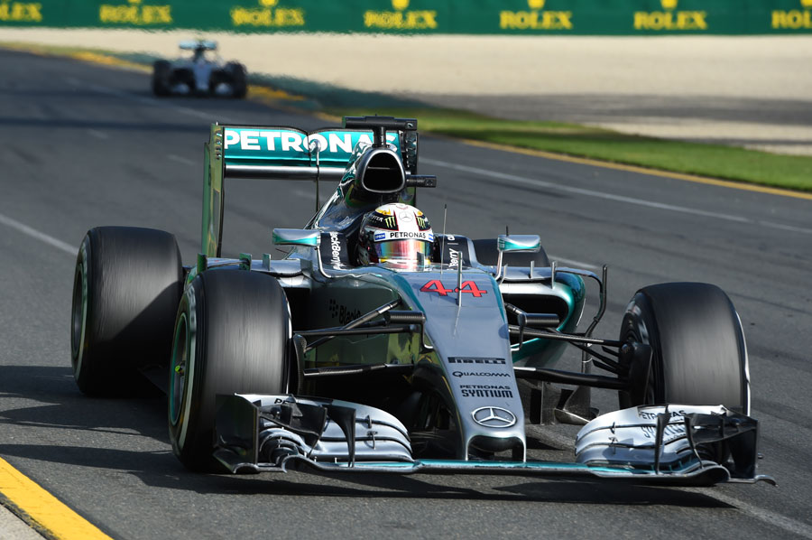 Lewis Hamilton approaches the penultimate corner with Nico Rosberg in the distance