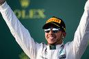 Lewis Hamilton celebrates his Melbourne victory on the podium