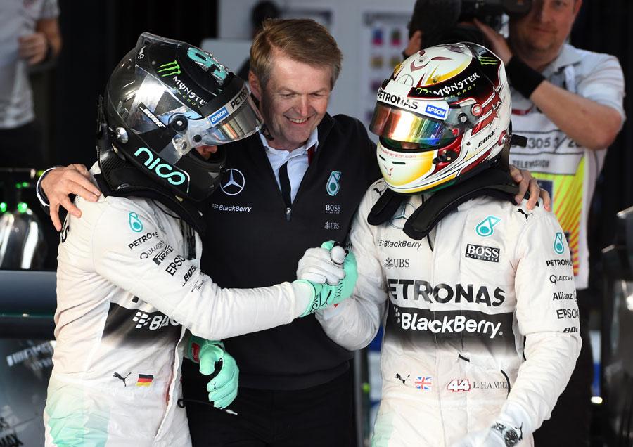 Nico Rosberg congratulates team-mate Lewis Hamilton on victory
