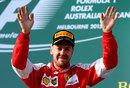 Sebastian Vettel celebrates securing a podium on his Ferrari debut
