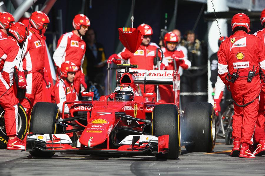 Kimi Raikkonen exits his pit box