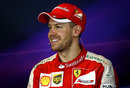 Sebastian Vettel is all smiles in the post-race press conference