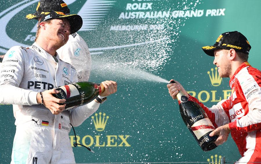 Nico Rosberg and Sebastian Vettel celebrate second and third on the podium