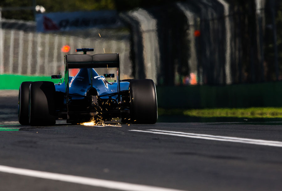 Sparks fly from the rear of Lewis Hamilton's Mercedes