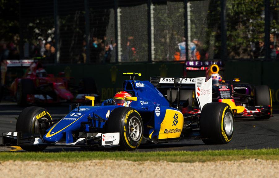 Felipe Nasr rounds Turn 3 with Daniel Ricciardo and Kimi Raikkonen in close company