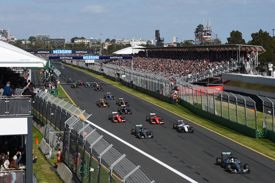 Lewis Hamilton leads the chasing pack down towards Turn 1