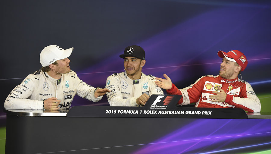 Nico Rosberg and Sebastian Vettel share a joke at the post-race press conference