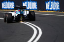 Sparks fly from the rear of the Williams