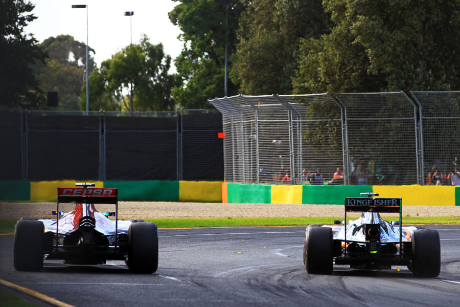 Carlos Sainz and Sergio Perez battle for position