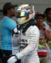 Lewis Hamilton gestures to the cameras after clinching pole