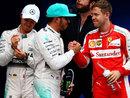 Sebastian Vettel congratulates Lewis Hamilton on taking pole