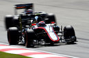Jenson Button leads a Force India on track
