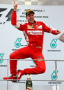 Sebastian Vettel leaps for joy on the top step of the podium