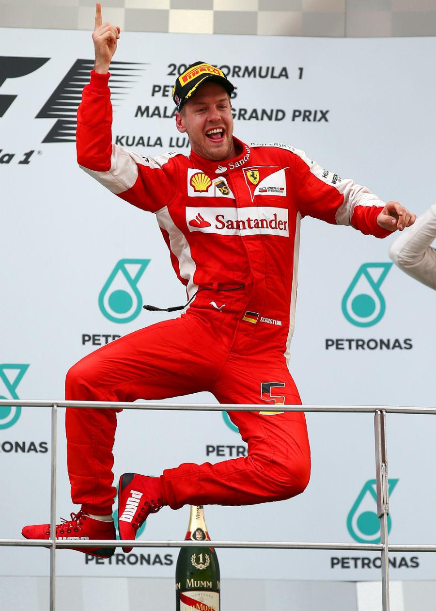 Sebastian Vettel leaps for joy on the top step of the podium