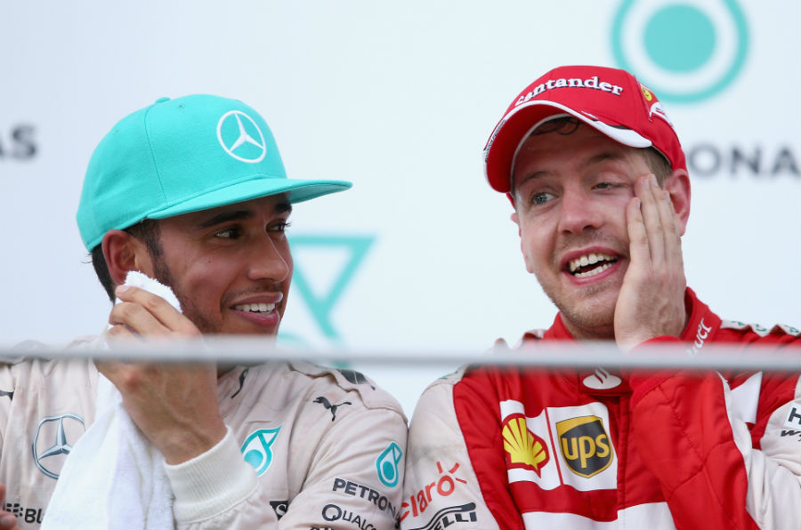 Lewis Hamilton sits with race-winner Sebastian Vettel on the podium