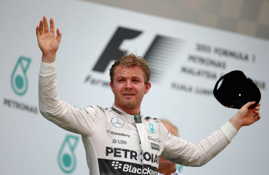 Nico Rosberg salutes the crowd from the podium after finishing third