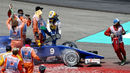 Marcus Ericsson climbs from his Sauber after beaching the car in the gravel