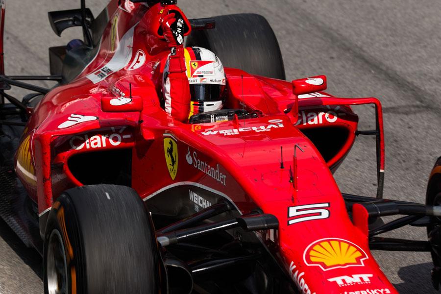Sebastian Vettel crosses the line for victory
