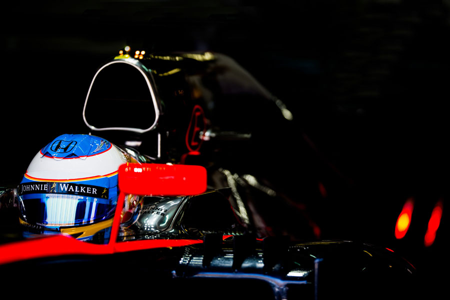 Fernando Alonso prepares to leave the garage