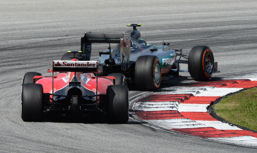 Kimi Raikkonen follows Nico Rosberg