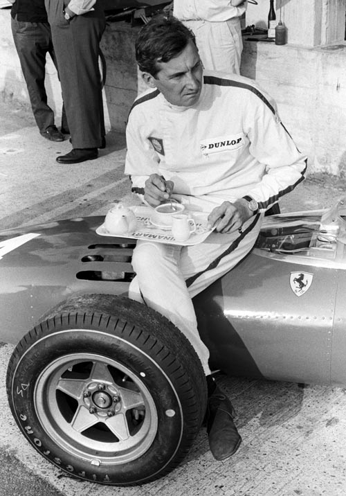 Mike Parkes takes afternoon tea at the 1966 Italian Grand Prix