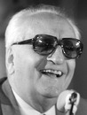 Enzo Ferrari at a press conference in 1975