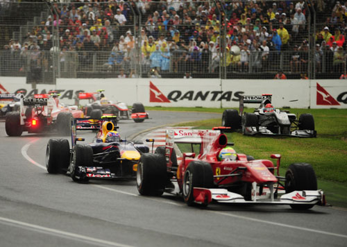 Mark Webber and Felipe Massa escape the first corner melee