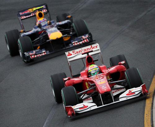 Felipe Massa keeps the Red Bull of Mark Webber behind him