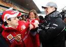 Michael Schumacher attempts to draw on Felipe Massa's coat