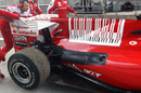 Fernando Alonso's disabled car is brought back to the garage