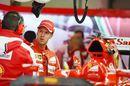 Sebastian Vettel chats with Ferrari engineers