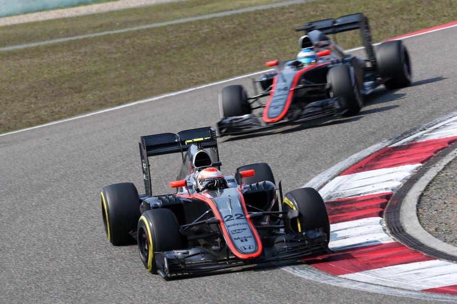Jenson Button leads teammate Fernando Alonso