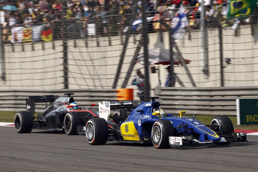 Marcus Ericsson leads Jenson Button