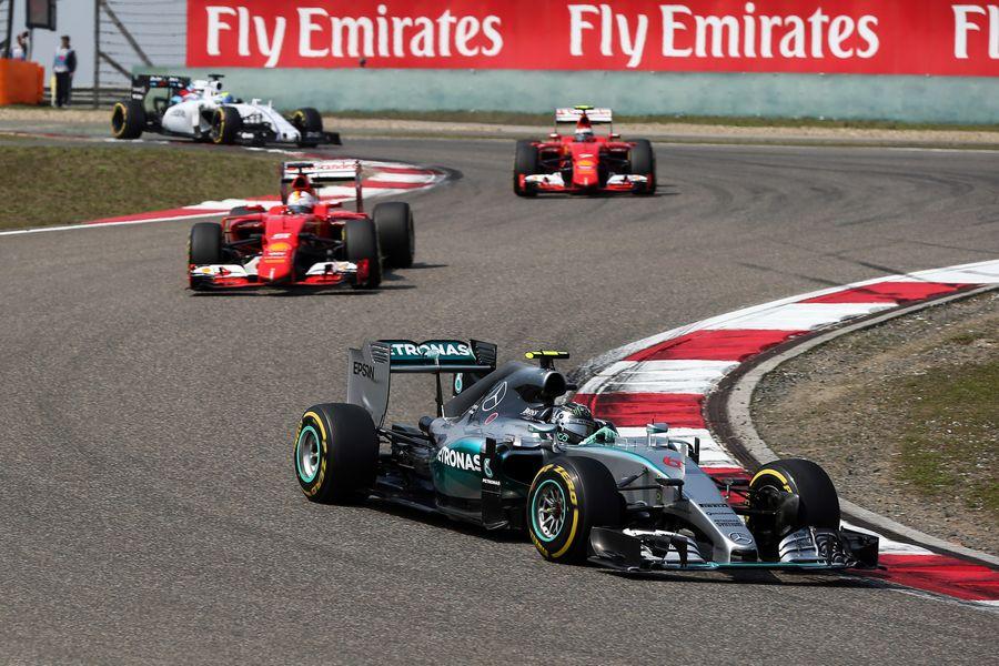 Nico Rosberg leads two Ferraris