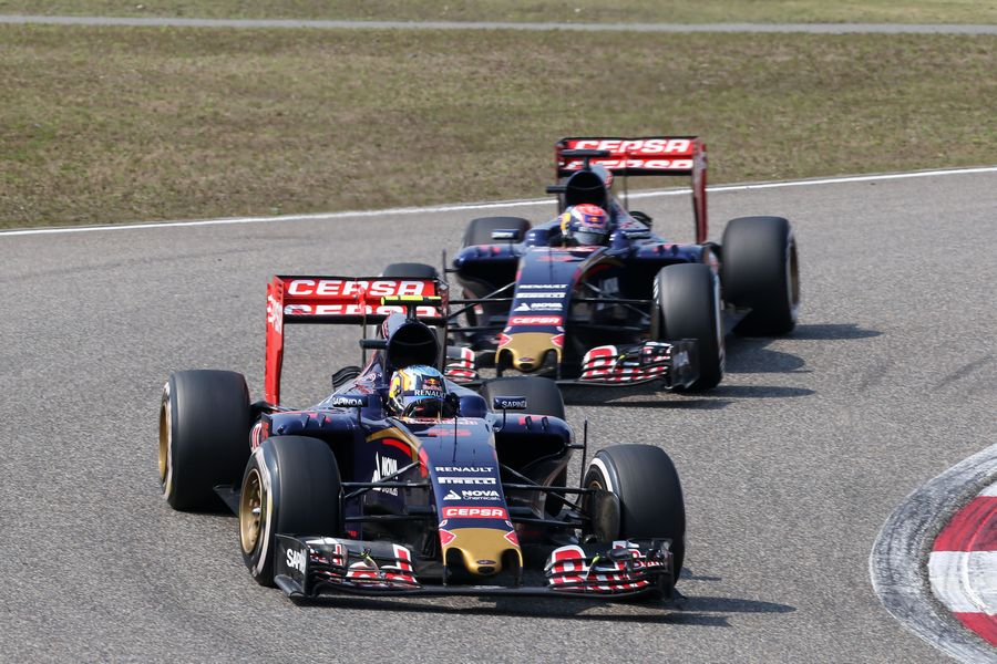 Carlos Sainz and Max Verstappen battle for a position
