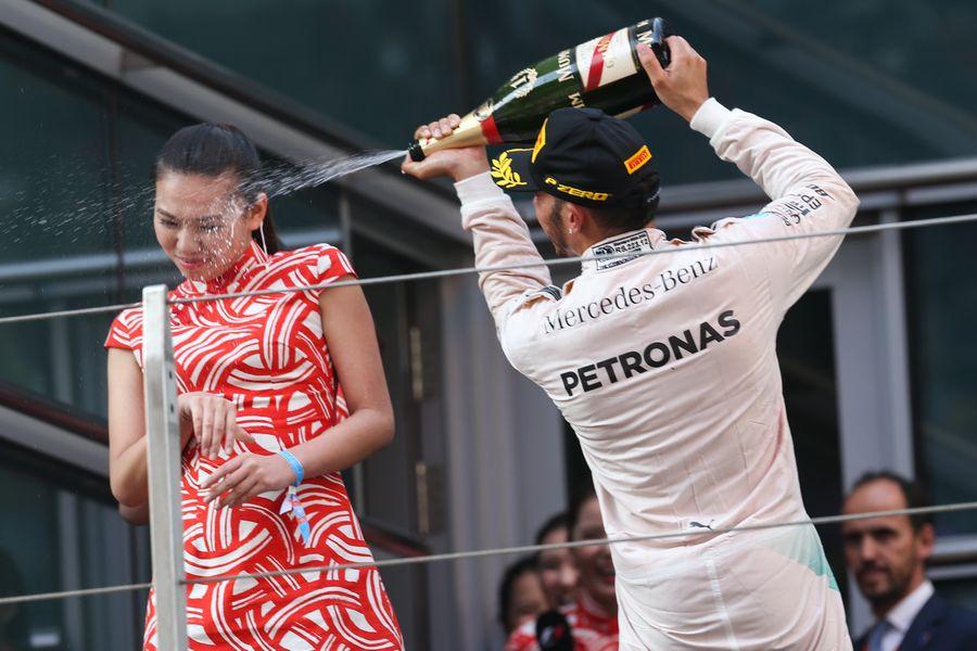 Race-winner Lewis Hamilton on the podium