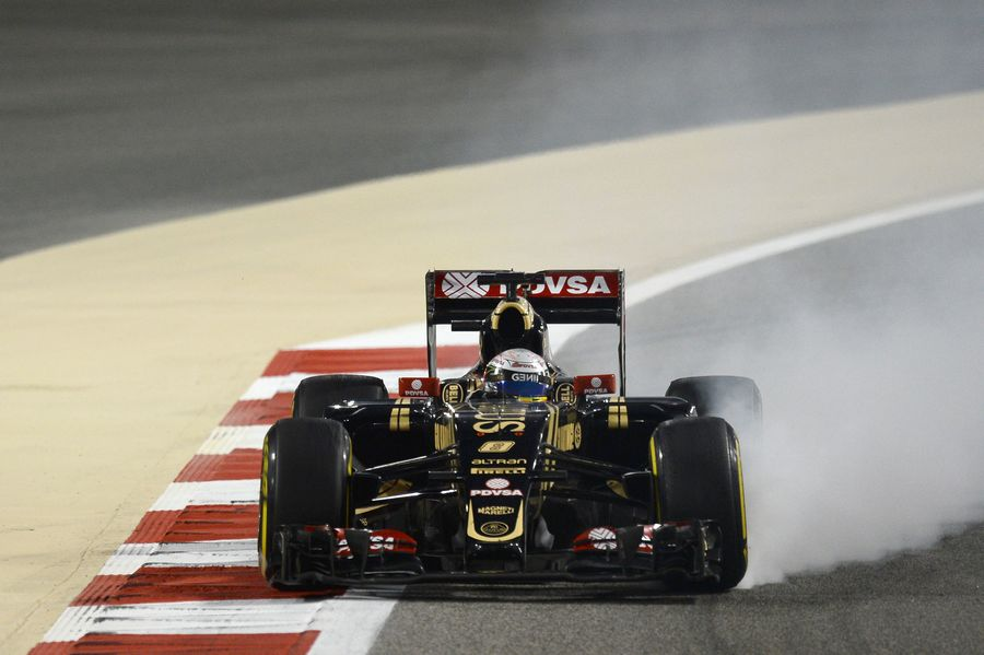 Romain Grosjean locks up in the Lotus