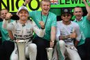Race winner Nico Rosberg and Lewis Hamilton celebrate with the team