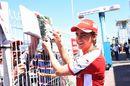 Esteban Gutierrez signs an autograph for fans