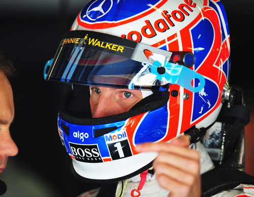 Jenson Button talks to his engineers