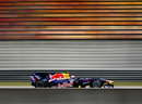 Mark Webber flashes past empty grandstands