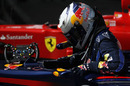 Sebastian Vettel gets out of his car after claiming pole