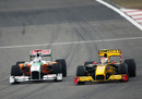Adrian Sutil battles with Vitaly Petrov