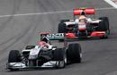 Michael Schumacher leads Lewis Hamilton