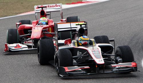 Bruno Senna chased by a Ferrari